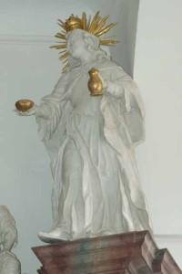 Barocke Frauenfigur ganz in weiss, mit goldener Krone, Heiligenschein, in den Händen trägt sie Brot und einen Krug, Betenbrunn, Foto © BHR