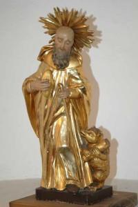Barocke Figur des heiligen Gallus. Auf seinen Wanderstab gestützt, in vergoldeter Mönchskutte blickt der Heilige sinnend nach unten, wo der Holz tragende Bär zu ihm aufschaut. Kathedrale St. Gallen