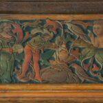 Die geschnitzte Bordüre zeigt das Christuskind mit segnender Geste. Davor kniet eine junge Frau - Katharina von Zimmern - und empfängt den Schleier.